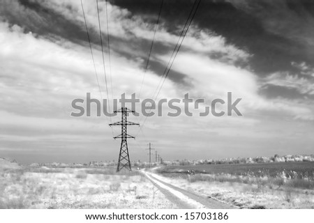 Landscape: road,  field, clouds and electric column. Monochrome - stock photo