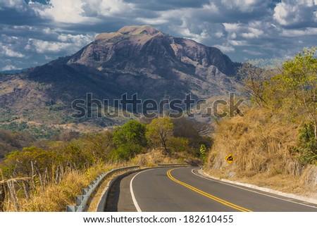 landscape road north of el Salvador in Cabanas department, central america, vulcano of el salvador - stock photo