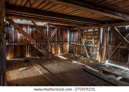 Landscape  ruins of an old industrial building. Interior of an old barn for processing hops, raw materials for production of expensive beers. Dark shining through holes in the walls. Selective focus. - stock photo