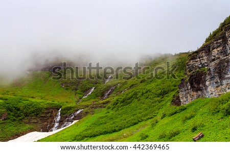 Landscape scenic with waterfall in Glacier National Park, Montana. Going to the Sun road. - stock photo
