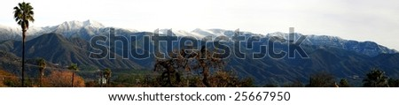 Landscape shot of the Ojai valley with snow on the mountains. - stock photo