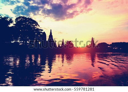 Landscape silhouette vintage style of Wat Chaiwatthanaram during sunset next to the Chao Phraya River is ancient temple famous religious attraction of Ayutthaya Historical Park, Thailand