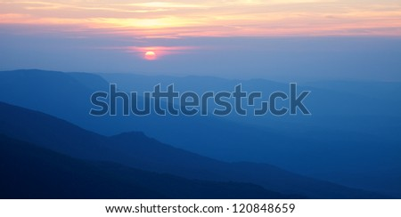 Landscape. Silhouettes of the mountains at sunset - stock photo