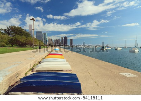 Landscape skyline view of the Lakefront trail in Grant Park along Lake Michigan in Chicago with a polarized blue sky.
