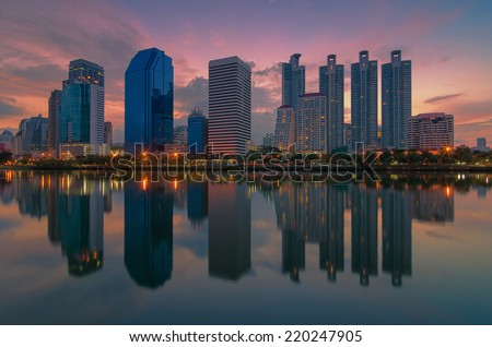 Landscape skyscraper business district at dawn sky, beautiful water reflection.