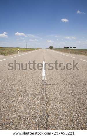 landscape straight rural grey lonely road in countryside of Spain Europe