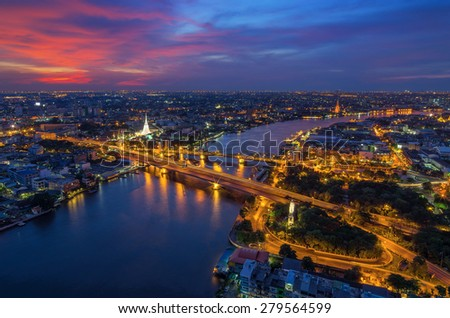 Landscape the area Phra Phuttha Yodfa Bridge is a bridge that links the capital to the communication between the Thonburi side of Bangkok at twilight. - stock photo