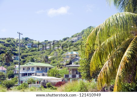 landscape typical houses Clifton Union Island St. Vincent and the Grenadines in Caribbean - stock photo