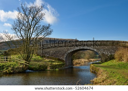 Landscape view of a bridge along the Lancaster Canal at Farleton in Cumbria, England.