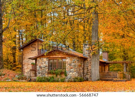 Landscape view of a home in the fall with all the colorful foliage - stock photo