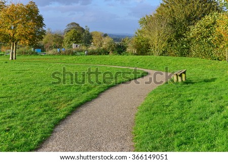 Landscape View of a Winding Pathway through a Beautiful Green Park - stock photo
