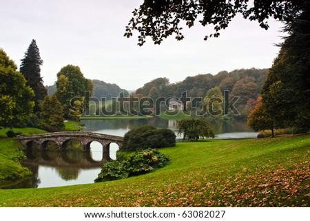 Landscape view of an English garden and lake. - stock photo