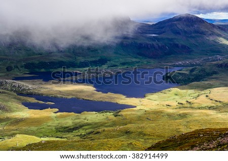 Landscape view of Inverpolly mountains and lakes in highlands of Scotland, United Kingdom