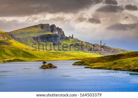 Landscape view of Old Man of Storr rock formation and lake, Scotland, United Kingdom - stock photo