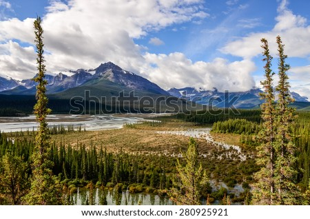Landscape view of river and montains near Icefield parkway, Rocky Mountains, Canada - stock photo