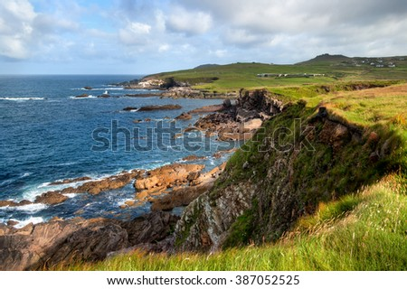 Landscape view over steep cliffs on Atlantic Ocean coast in County Antrim, Northern Ireland  - stock photo