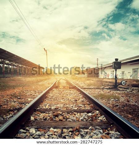 Landscape vintage of railroad tracks at train station with retro filter effect  - stock photo