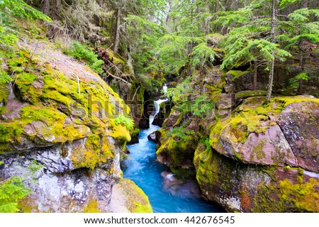 Landscape waterfall image of Avalanche Creek in Glacier National Park, Montana. - stock photo