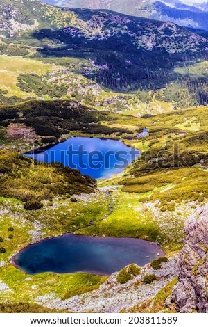 Landscape with a glacial lake in the highlands of Fagaras mountains, Romania