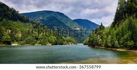 Landscape with a lake in the mountains in a rainy day - stock photo