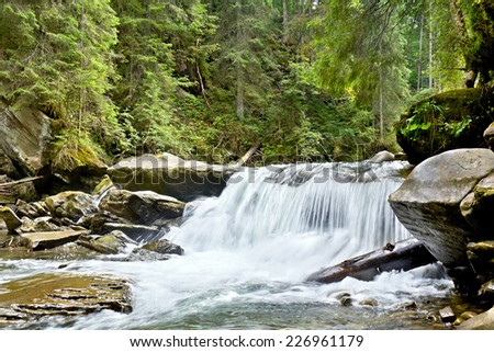 Landscape with a mountain river in a summer day - stock photo