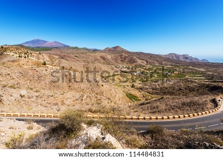 landscape with a road through a valley on Mount Teide - stock photo