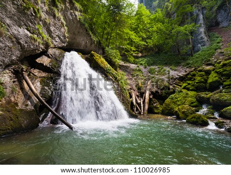 Landscape with a waterfall in a summer day - stock photo