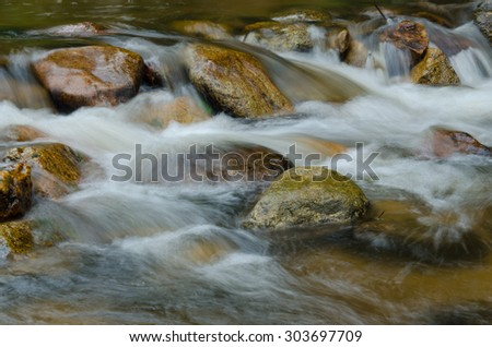 Landscape with a waterfall, milky water  in a summer day. - stock photo