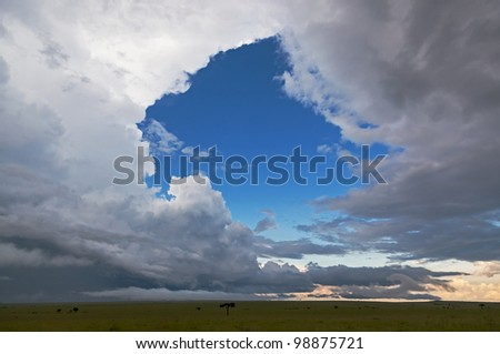 Landscape with a window in heaven in savannah on the Masai Mara National Reserve - Kenya - stock photo