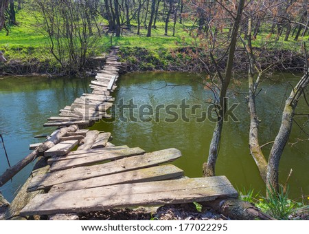landscape with a wooden bridge over the river