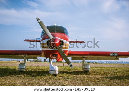 Landscape with aircraft. Propeller, wings and fuselage of the airplane at the airfield. Small aviation - air transport for travel on the sky. - stock photo