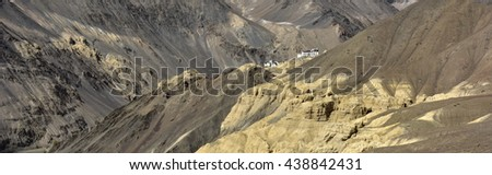 Landscape with an ancient Tibetan Buddhist monastery of Lamayuru Gonpa, Bon tradition, the view from the unique mountain location Moon Land, Ladakh, Himalayas, Northern India. - stock photo