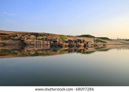Landscape with Balancing Rock and water reflection - stock photo
