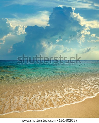 Landscape with beach, sea and clouds - stock photo