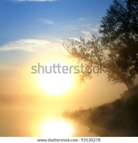 landscape with beautiful fog sunrise on river - stock photo