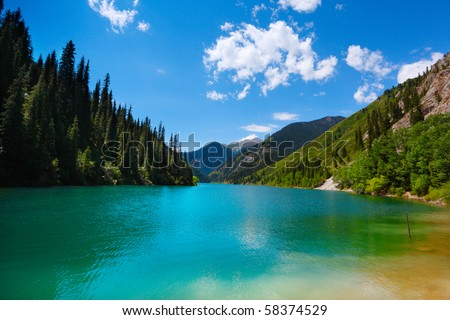 Landscape with beautiful mountain lake - stock photo