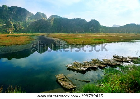 Landscape with boat in Van Long natural reserve in Ninh Binh, Vietnam