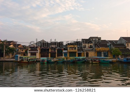 Landscape with boats ancient house in Hoi An, Vietnam - stock photo