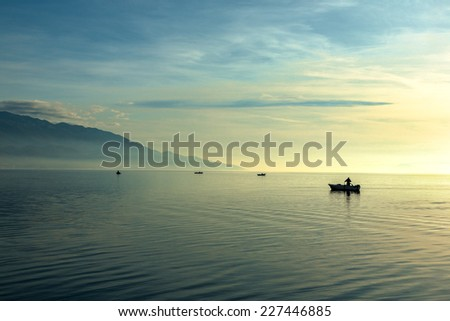 Landscape with boats and sea - stock photo