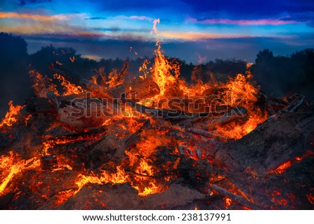 landscape with bonfire, night and bright hot flame. - stock photo