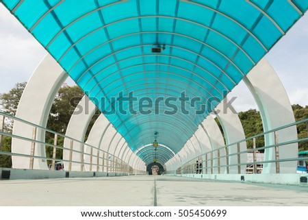 Landscape with bottom view of a Blue Translucent roof walkway at Samed Island east of Thailand