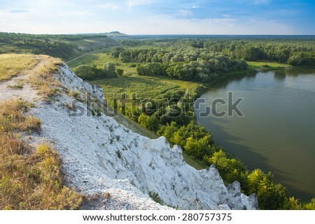 Landscape with chalk mountains and the river - stock photo
