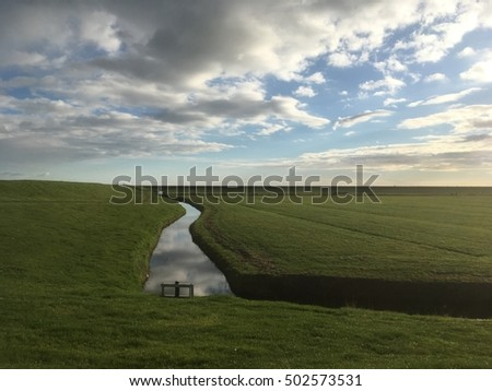 Landscape with clouds reflection in a ditch, Terschelling the Netherlands