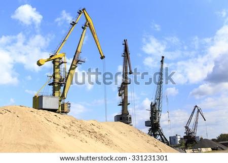 landscape with construction cranes. Industrial landscape with standing in a number of construction cranes - stock photo