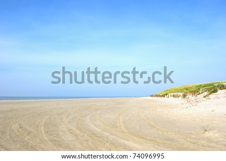Landscape with dunes and empty quiet beach - stock photo