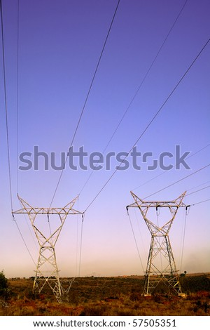 Landscape with Electrical Pylons - stock photo