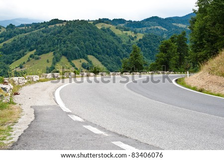 Landscape with empty road and trees under the sky - stock photo