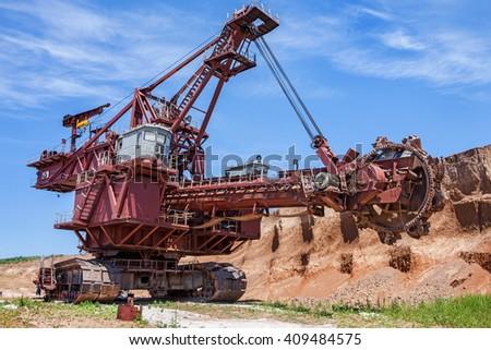 Landscape with extractive industry giant bucket wheel excavator - stock photo