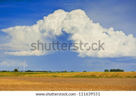 Landscape with fields and beautiful clouds - stock photo