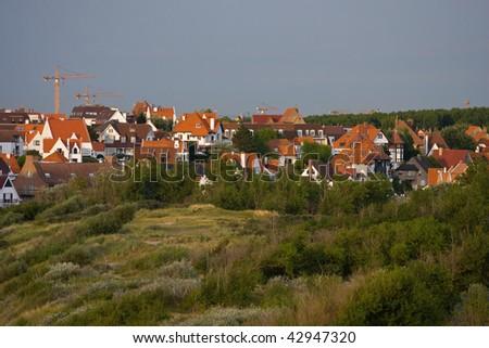 Landscape with flemish style houses - stock photo